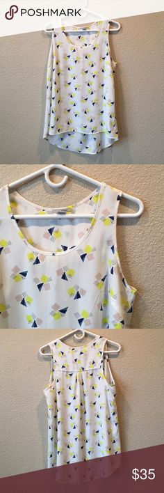 Halogen White High-low Tank Blouse Excellent condition. Some signs of wear. Cute yellow tan blue geometric design. 100% poly. Offers welcome through offer tab. No trades. Halogen Tops Tank Tops
