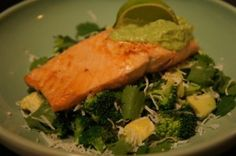 Salmon served on cilantro salad with thick coconut sauce #paleo