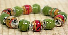I have been playing with the idea of making Pandora style paper beads. I had bought some metal bead cores (you can get a pack of 500 for less than Paper Beads Tutorial, Paper Beads Template, Make Paper Beads, Paper Bead Jewelry, Fabric Jewelry, How To Make Beads, Beaded Jewelry, Beaded Bracelets, Bead Crafts