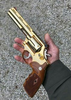 """This is a Smith & Wesson K-Frame Revolver with a Colt Python Barrel. Affectionately called """"Smolts"""", this modification was popular before Smith & Wesson introduced the midsized L-Frame Revolver. Weapons Guns, Guns And Ammo, Katana, Revolver Pistol, Revolvers, Colt Python, Custom Guns, Concept Weapons, Fire Powers"""
