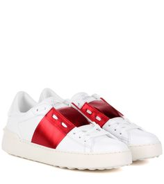 Valentino - Valentino Garavani Open leather sneakers - Valentino Garavani offers a refreshing take on the classic white sneaker. This pair is adorned with the brand's signature pyramid studs to the heel in a rubber effect, while the upper features a red stripe in shining metallic leather for contrast. Wear yours with anything from fringed denim to frilly skirts. seen @ www.mytheresa.com