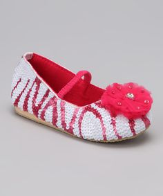 Tiny tots need these teensy treats for feet! Featuring a classic silhouette and ample shimmer, this pair promises to keep steps on track and sweetly sparkled.Man-madeImported