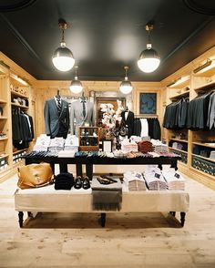 Retail Store Design Rustic Photo - Clothing on display at the J.Crew Men's Shop