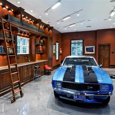 Yes, this is really a garage. But, we have to have things to look forward to, don't we? Fancy - Luxury Garage Environments by Garage Mahals