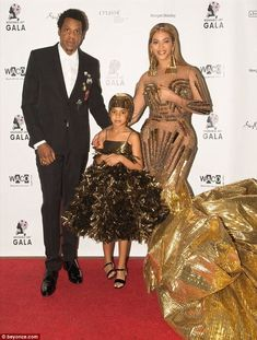 Party of three: The was accompanied in her flurry of pictures by rapper husband Jay-Z and their six-year-old firstborn daughter Blue Ivy Blue Ivy Carter, Nude Gown, Gold Gown, Destiny's Child, Beyonce Family, Beyonce Style, Jüngstes Kind, Beyonce Knowles, 1990s