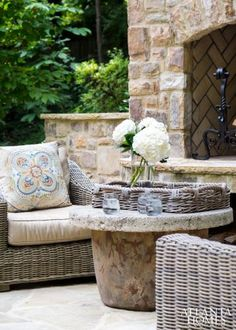 sitting area by an outdoor fireplace
