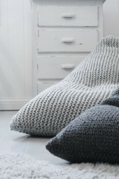 could upcycle old knitted or crocheted throw blankets to make larger versions.