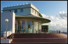 Art Deco... | The Midland Hotel is a famous Art Deco building in Morecambe, Lancashire, England. It was built by the London, Midland and Scottish Railway (LMS), in 1933, to the designs of architect Oliver Hill, with sculpture by Eric Gill.