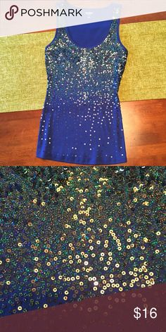 Sparkle fitted tank top! Super cute! It starts with a lot of sparkles at the top and gradually fades! It's fitted and looks great with a pair of jeans! Express Tops Tank Tops