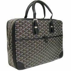 Goyard. I am coveting this bag...