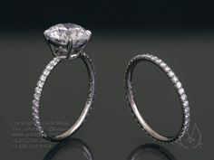that super thin diamond encrusted band with that one lovely rock... GORGEOUS!