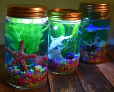 Looking for a fun craft to celebrate the new Disney/Pixar Finding Dory movie? Check out these Light Up Mason Jar Aquariums!