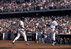 Bill Russell congratulates Reggie Smith after he hits a home run in the sixth inning of Game 5 of the 1977 World Series.