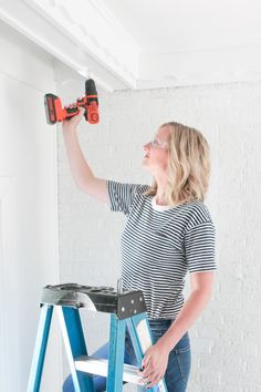 Drilling pilot holes into a wood beam to secure a hook for planters. Come watch this video tutorial to learn how to use a power drill to hang planters from a ceiling Hang Plants From Ceiling, Ceiling Hooks, Plant Hooks, Hanging Plants, Indoor Plants, Greenhouse Pictures, Christmas Tree Template, Change Your Eye Color, Diy Playbook
