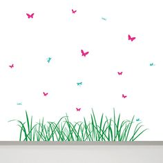 This large wall decal with a long piece of grass, 9 butterflies and 6 dragonflies will give your nursery or any other room in your house all year
