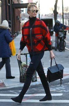 Karlie Kloss Zip-up Jacket - Karlie Kloss brightened up the pavement with her red and black Esprit by Opening Ceremony wool poncho that she paired with Soelae Sunday Somewhere sunnies while out in New York City.