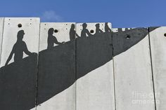 Israeli Photograph - A Banksy Graffiti On The Separation Wall In Palestine by Roberto Morgenthaler