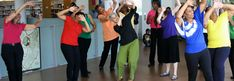 Creative Aging Programs for Public Libraries. Photo of women dancing during a creative aging workshop at Grove Hall Library, part of the BPL