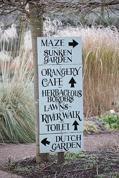 HAMPTON COURT CASTLE AND GARDENS, HEREFORDSHIRE: SIGN IN THE WALLED GARDEN IN FROST by Clive Nichols photographer