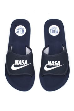 VFILES NAVY NASA SLIDES Navy blue pool slide sandals featuring white stitched NASA logo. Comfy foam soles and polyester velcro upper. A VFILES exclusive! Made in the USA. SIZE & FIT S fits women's 5-6.5 M fits women's 7-8.5 L fits women's 9-10.5 and men's 8-9 XL fits women's 11-12.5 and men's 9.5-10 XXL fits men's 10.5-12 VFILES + NASA VFILES has teamed up with DJ Scotto, founder of the iconic underground party NASA on a capsule collection of hoodies, crewnecks, t-shirts, tanks, and…