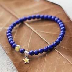 Design: Genuine Real Natural Lapis Lazuli, Handmade December Birthstone Jewelry for Women.Tiny Healing Crystal Bracelet .In Stock: 3-5 days for processingInclude: A BraceletCustom: NoColor: BlueMaterial: Lapis Lazuli,Silver 925Bead Approximate Dimensions: Lapis Lazuli Bead 5mmBracelet Length: 16 cm,17cm,18cm Lapis Lazu