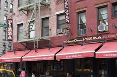 Lombardi's Pizza NYC - the oldest pizzeria in america. 32 Spring Street, Between Mott St and Mulberry St. Try the white or the sweet sausage. Whole pie's only.  $15-$20. Yelp