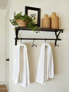 Get Hooked - Simple shelves and hooks help organize the bath and keep essentials off the countertops and floors. Easy-to-assemble shelves are available at home centers and hooks are an inexpensive way to hang towels and robes.