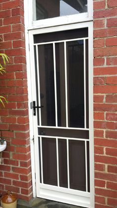 Steel security door with stainless stainless steel mesh installed in Brighton.