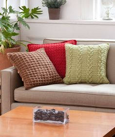 Crochet stitches add interest to your décor with these three pillow covers—Subtle Texture in Wine, Waffle Weave in Toast and Braided Cables in Leaf. All feature the same back with button band, so you can remove covers and easily wash them.