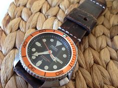 "Seiko Vintage Diver ""Planet Ocean Mod"" on brown leather strap."