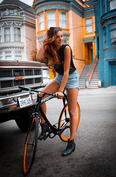 Bike, Bike fashion, girl on a bike, model on a bike, beautiful bike girl, orange, carbon frame, belt drive bicycle, San Francisco Bikes