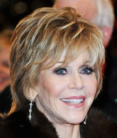 One of the most flattering haircuts  takes bangs perfectly. Jane Fonda's layered bangs and hair frame her face and eyes perfectly