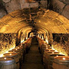 Napa vs. Sonoma face-off | Napa: Tasting rooms | Sunset.com  Wine taste in the cave at Del Dotto