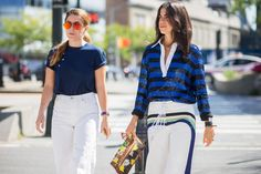 Leandra Medine wears a sequin rugby shirt, lace-up pants, and a floral clutch