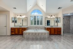 Spa-like en suite with vaulted ceiling, recesssed lights, soaking tub, glass enclosed shower, tile flooring and dual sinks and vanities. Listed in Oakton, VA for $1.6M byThe Casey Samson Team, a Wall Street Journal Top Team in Northern Virginia.