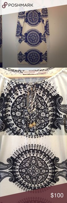 1 DAY SALE  Juicy Couture Dress/swimsuit cover A little big on me so selling.  Black and off White.  One of the most beautiful dresses I've seen.  Made to be a swimsuit cover up or dress.  Hate to sell but need to make room for things that fit me better.  Gold balls on tassel. Juicy Couture Dresses