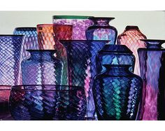 Beautifully arranged jewel tone vases