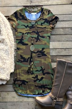 Our There's Your Trouble Bodycon Dress is for all you camo lovers out there! It's a short sleeve bodycon dress with scoop neckline and slits slightly up the sides. Unlined.