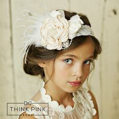 """This adorable couture headband is a true fit for a princess!!!Vintage inspiredarray of hand made flowers, feathers, pearls and tulle over a wide soft stretchy lace headband. Measurement: around 5"""". Available in 4 colors Pair this headband with one of our adorable dresses for a complete look.These cute headbandsare your wardrobe's new best friend! Size Chart: Newborn: 13"""",0-3 Months: 14"""",3-6 Months: 15"""",6 Months - 3 Years: 16"""",4 Years to teens: 17"""", Adult: 19"""""""