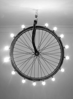Hand made lighting wheel | Lighting Wheel is a festive design made from a discarded bike tire and a few light bulbs. Comes in two sizes wheel 20 and wheel 24 | https://www.behance.net #lighting #homedecor