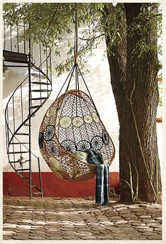 """I'm usually loath to look at anything labeled """"Hot Trend"""" but we've got a great spot for a hanging chair in our current living room."""