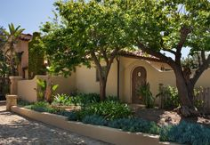 Front yard – front entry – Mediterranean – stucco wall – Hardscape change