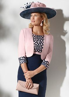 Short dress with gently tiered skirt and embroidered bodice. The outfit is completed by waist length collarless bolero jacket with matching embroidery on the cuffs.