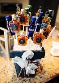 An alcohol bouquet makes a great gift for a groom and his groomsmen! Wedding design by Visions. Photo by Tara Lokey Photography. #wedding #groom #alcoholbouquet
