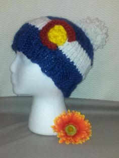 style: fitted CO colors: traditional with white pompom size: adult