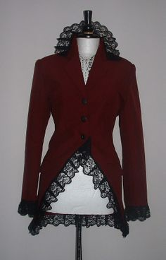 LADIES long red jacket with lace trimming.