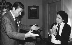 Helen Thomas, who covered 10 presidents in nearly 60 years with United Press International, died July 20, at the age of 92. Pictured here, President Ronald Reagan greets Thomas on April 22, 1981 in the Treaty Room at the White House in Washington. Reagan granted an interview with UPI and described the March 30 attempt on his life