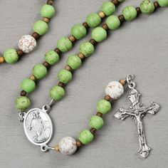St. Patrick Rosary - This St. Patricks Rosary marries Irish cheer and reverence with shamrock shaded beads perfected with a St. Patrick medal centerpiece and traditional crucifix.