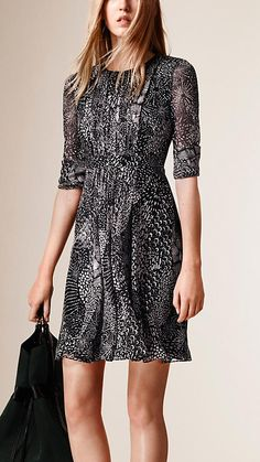 Burberry Graphic Print Dress in Lightweight Silk Crepe. Cut in a flattering flared shape, the dress is tailored with a pleated design and sheer long sleeves. Discover the women's dress collection at Burberry.com