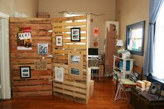 10 Home Ideas Using Recycled Wooden Crates and Pallets-3. Room Dividers This is a great way to section off parts of your house, or even use to hide any blemishes. Not only is it a partitioner, but also great for decoration. Via: My Friend Staci